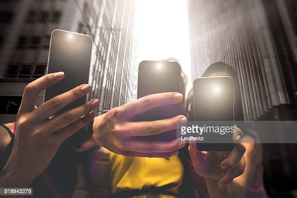 Group of teenagers photographing with mobile phones