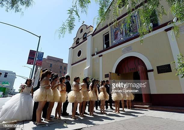 A group of teenagers takes part in a quinceanera celebration before taking part in the third annual Grand Marian Europeanstyle procession from La...