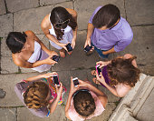 Group of teenagers using mobile phones