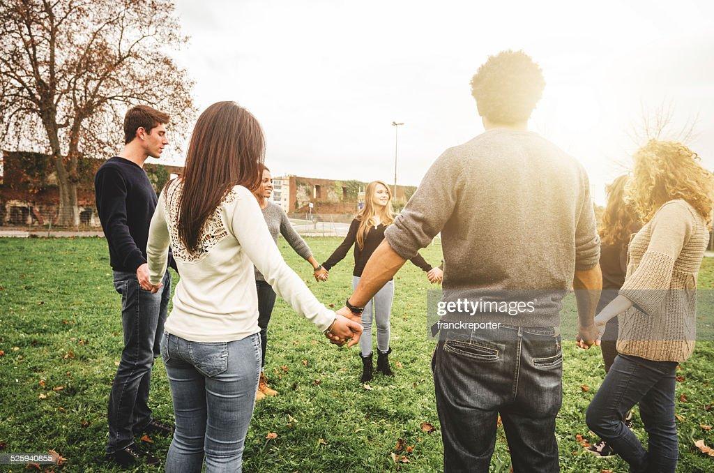 Group of teenagers volunteer happiness in circle