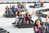 Group of teens riding go carts