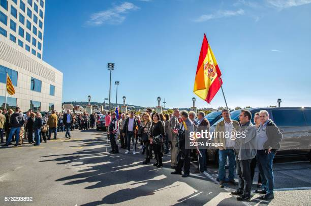 A group of the Popular Party supporters with flags await the departure of President Rajoy The Popular Party of Catalonia has counted with the...