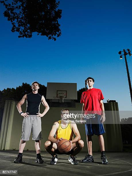 Group of three male basketball players on outdoor