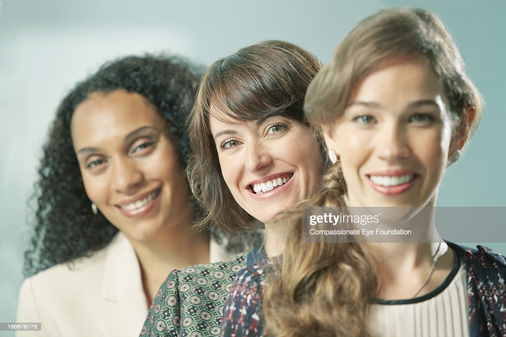 Group of three woman looking at camera : Stock Photo