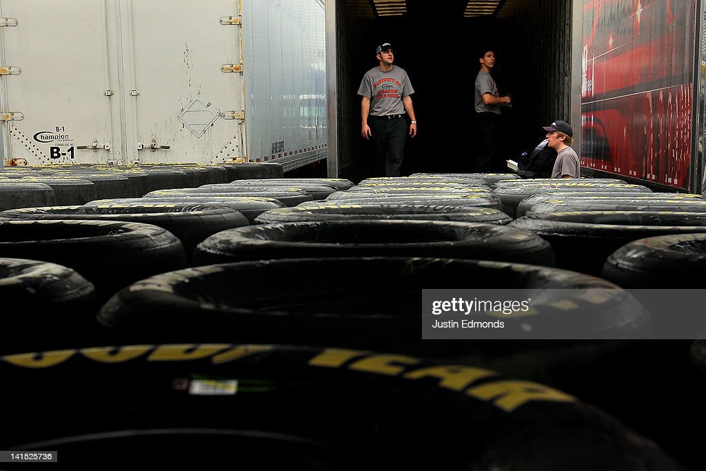 A group of tire movers look out of their truck as the rain falls prior to the NASCAR Sprint Cup Series Food City 500 at Bristol Motor Speedway on March 18, 2012 in Bristol, Tennessee.