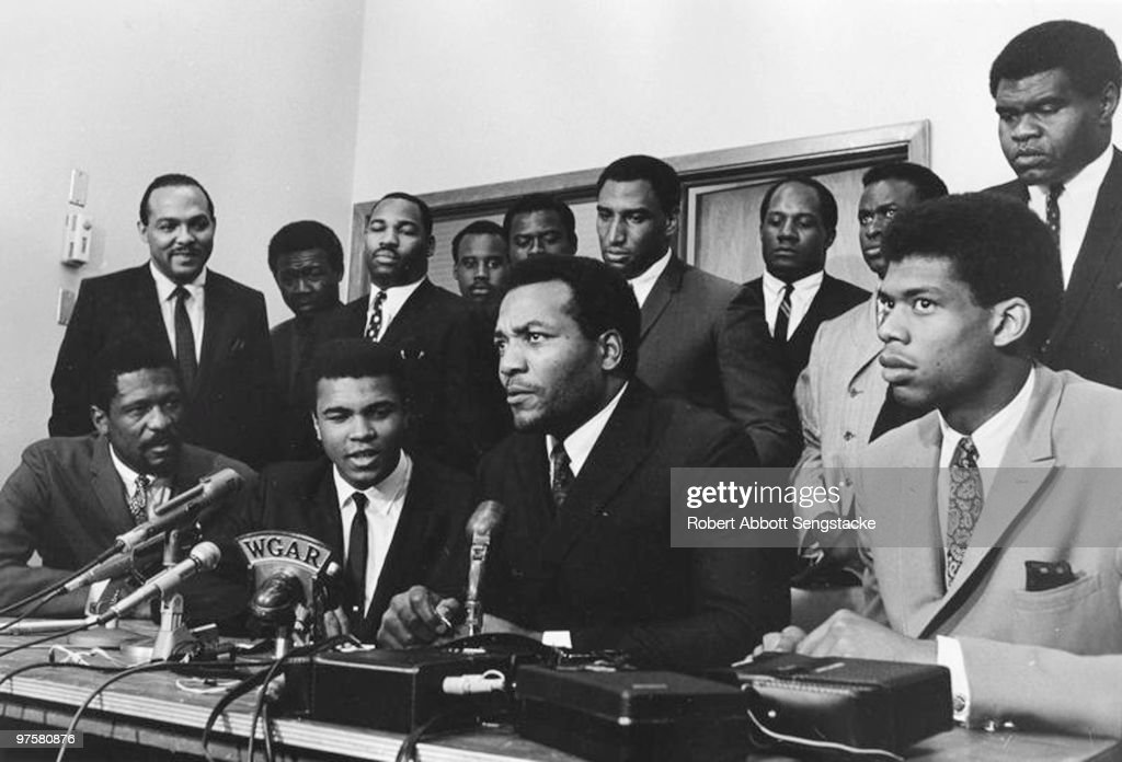 A group of top African American athletes from different sporting disciplines gather to give support and hear the boxer Muhammad Ali give his reasons...