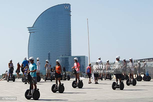 A group of tourists enjoy a Segway tour in La Barceloneta suburb in Barcelona on June 28 2015 Tourists generated 14% of municipal GDP but these 27...