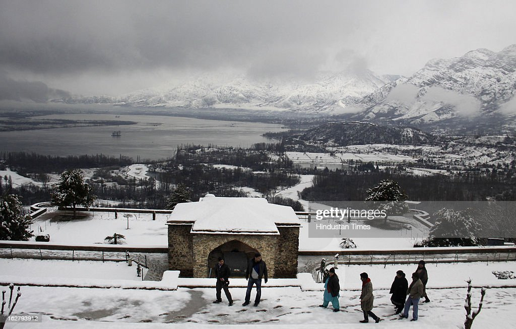 A group of tourists enjoys fresh snowfall at Pari Mahal, on February 27, 2013 in Srinagar, India. Kashmir valley was hit by a fresh spell of rains and snow during the preceding night of February 26 and 27.