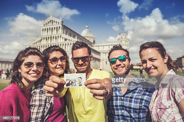 Group of tourists in Piazza dei Miracoli of Pisa