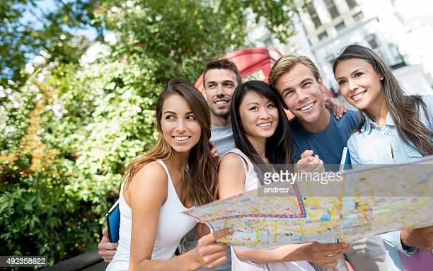 Group of tourists sightseeing and holding a map
