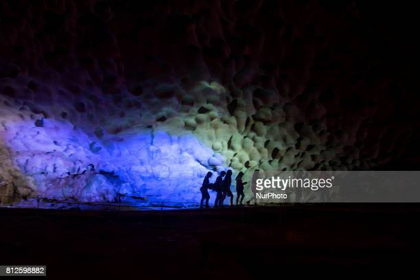 A group of tourists travels the interior of the cave of Hang Sung Lot in the bay of Halong The bay of Ha Long is an extension of water of...