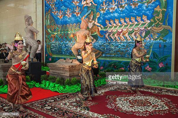 A group of traditional Cambodian Apsara dancers dance in front of the Balarama Duryodhana and Bhima statues during a ceremony to handover the three...
