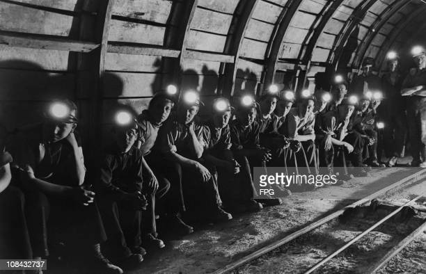 A group of trainee miners wait underground for a train that will take them to the coal face at the Markham colliery in Derbyshire England circa 1950