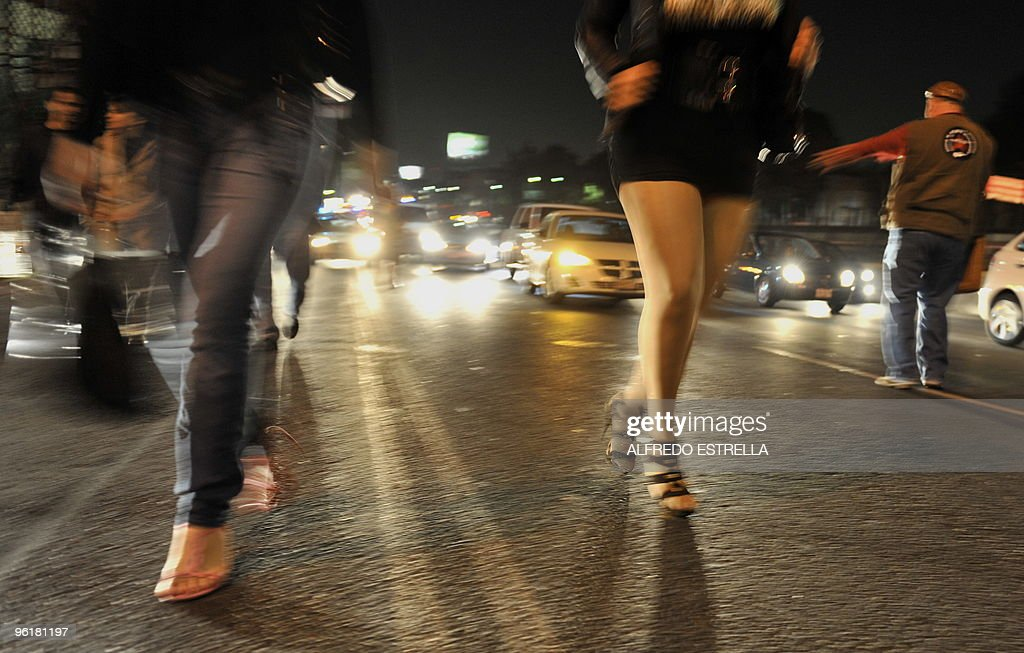 A group of transvestites and sex workers are seen during a a protest for abuse against sex workers on Tlalpan Avenue in Mexico City on January 25...