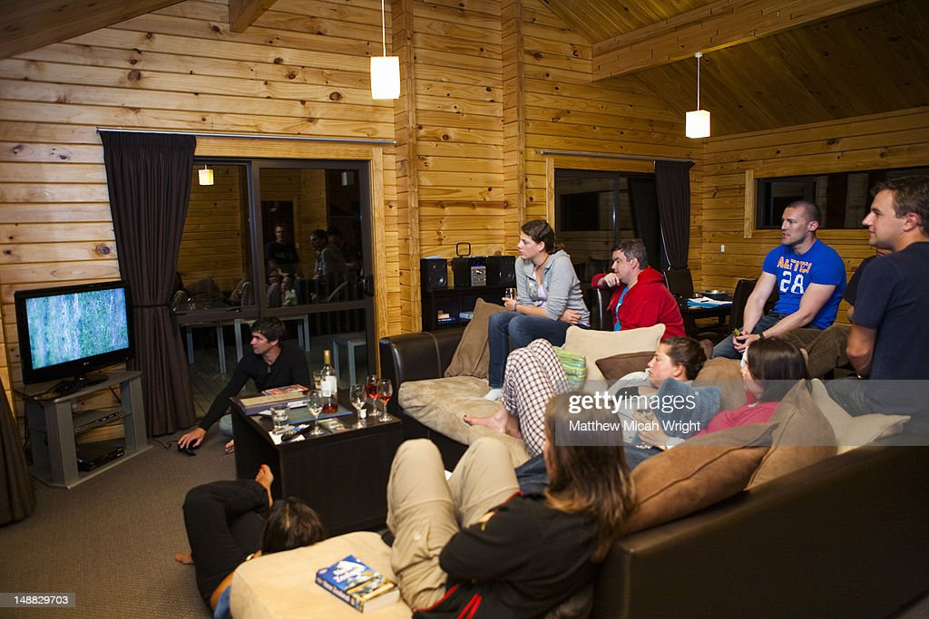 A group of travelers relaxes and enjoyes each others company in a plush Hamner Springs lodge called Green Acres Hotel : Stock Photo