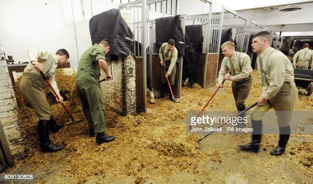 A group of Troopers of the Household Cavalry muck out the stables at the Knightsbridge Barracks in central London