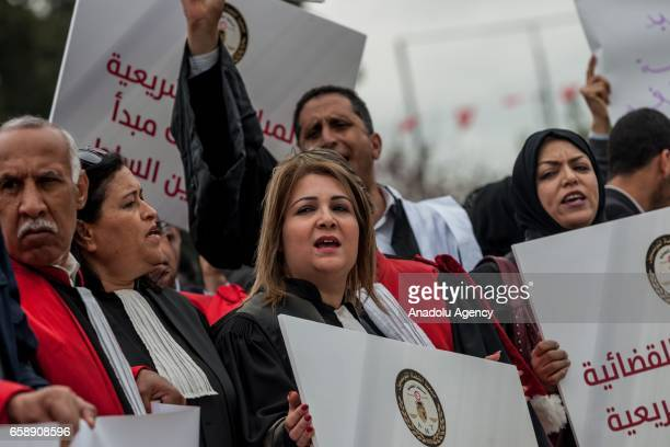 A group of Tunisian judges stage a demonstration protesting higher judicial commission resolution that proposed to the parliament on March 28 2017 in...