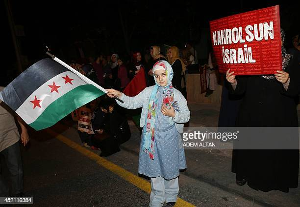 A group of Turkish protesters protest against Israel's attack on Gaza outside the Israeli embassy residence in Ankara Turkey on July 14 2014 AFP...