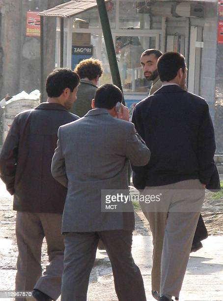 A group of Uighurs walk down the street in Tirana Albania US President George W Bush arrives in Albania Sunday his first visit since Albania agreed...