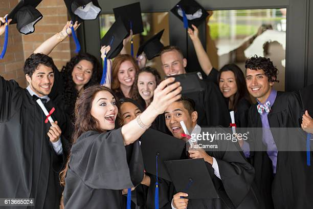 A group of university students wearing graduation gowns