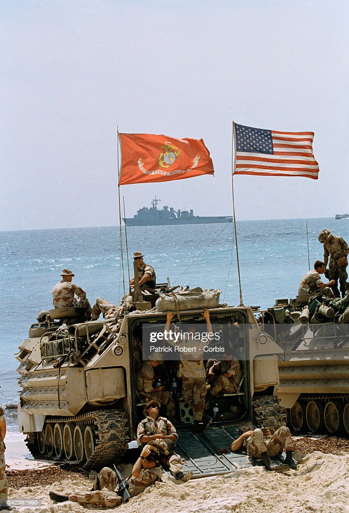A group of US Marines wait on the beach for the arrival of President George Bush who is arriving in Somalia in support of Operation Restore Hope...