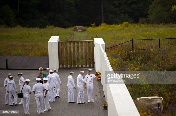 A group of US Navy men gather during 13th anniversary ceremonies commemorating the September 11th attacks were conducted at the Wall of Names at the...