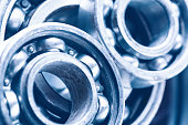 Group of various ball bearings as a background. Close up image with selective focus. Machinery background