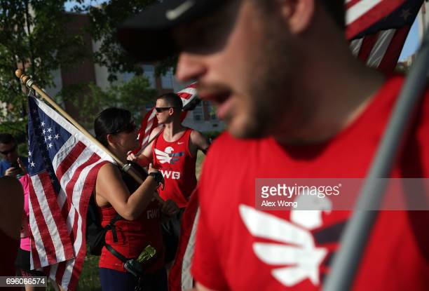 A group of veterans participate in a run/walk event to show solidarity after a shooting at the Eugene Simpson Stadium Park June 14 2017 in Alexandria...
