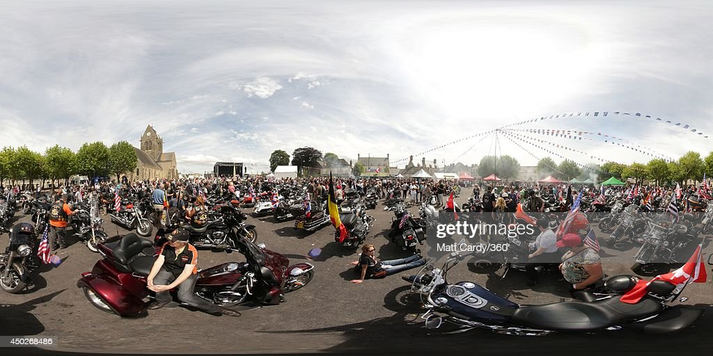 A group of visitors with motorbikes visit the main square of Sainte-Mere-Eglise which is holding D-Day Commemorations on June 7, 2014 in Normandy, France. Yesterday was the 70th anniversary of the D-Day landings, which saw 156,000 troops from the allied countries including the United Kingdom and the United States join forces to launch an audacious attack on the beaches of Normandy, these assaults are credited with the eventual defeat of Nazi Germany.