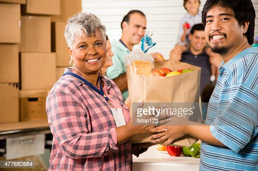 Group of volunteers provide groceries donations to needy families. Charity.