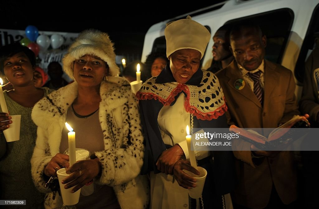 A group of well wishers hold candles as they pray for the recovery of Nelson Mandela outside the Mediclinic heart hospital in Pretoria on June 26, 2013. Mandela is receiving treatment at the Mediclinic heart hospital in Pretoria. Mandela's close family gathered yesterday at his rural homestead to discuss the failing health of the South African anti-apartheid icon who was fighting for his life in hospital. Messages of support poured in from around the world for the Nobel Peace Prize winner, who spent 27 years behind bars for his struggle under white minority rule and went on to become South Africa's first black president.