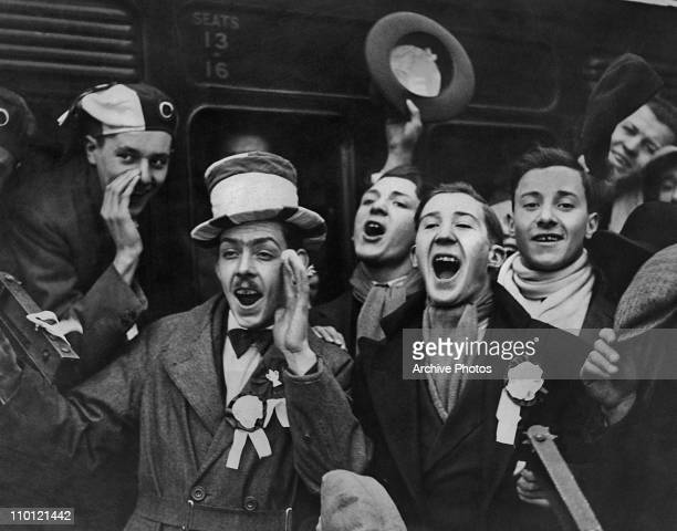 A group of West Ham supporters cheering as they leave Waterloo Station for a match at Boscombe 22nd August 1929