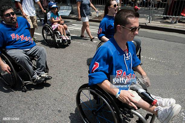 A group of wheelchair bound friend who play a modified game of hockey participate in the first annual Disability Pride Parade on July 12 2015 in New...
