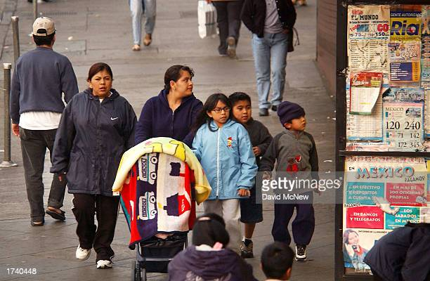 A group of women and children walk down a street in a predominantly Latin American immigrant section of the community of Westlake on January 22 2003...