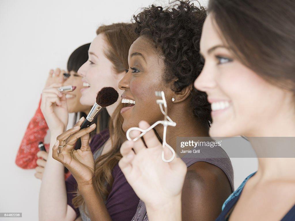 Group of Women Applying Make Up