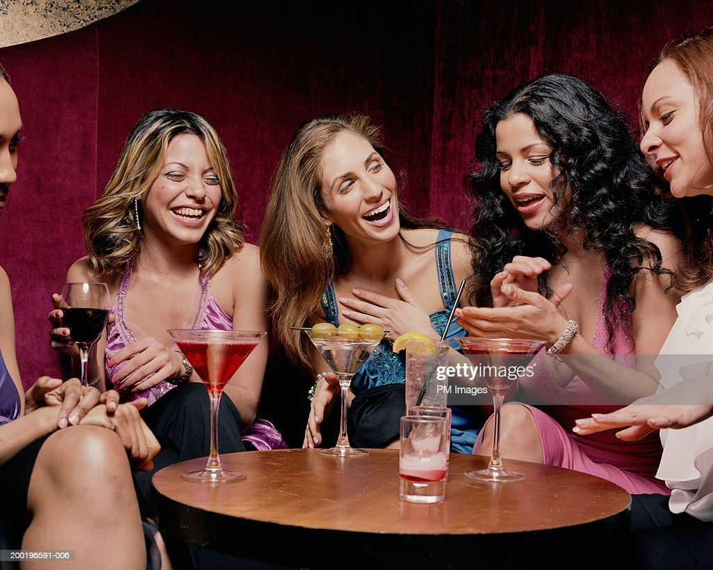 Group of women at table talking and laughing : Stock Photo