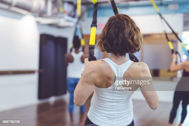 Group of Women Doing TRX Workout