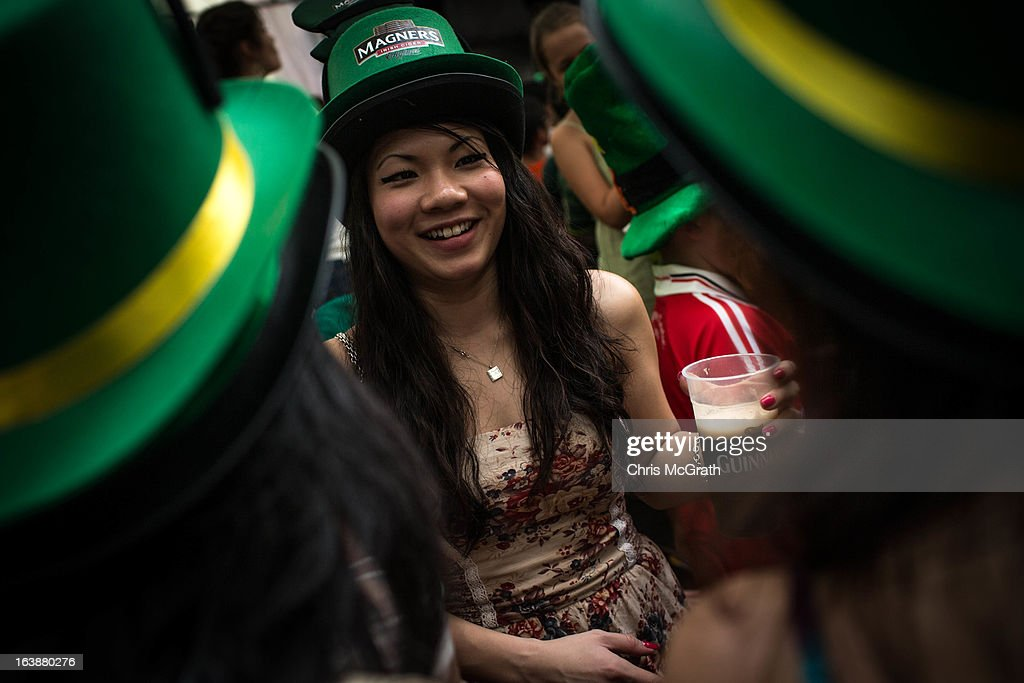 A group of women drink beer and celebrate St Patricks Day during the Singapore St Patrick's Day street Festival at Boat Quay on March 17, 2013 in Singapore. Singapore's Irish community gathered at Boat Quay for a three-day-long St Patrick's Day Street Festival which featured street performances, buskers, and Irish food and drink.