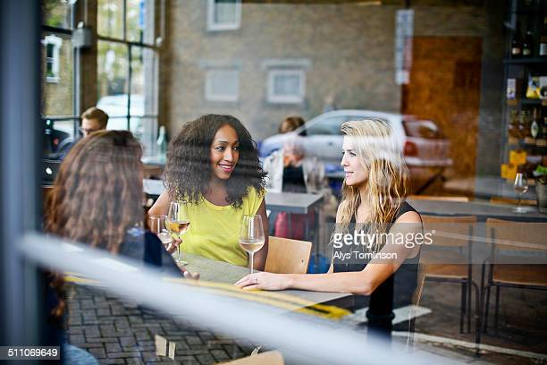 Group of Women Drinking Wine in a Bar