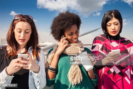 Group of women friend texting on their mobile