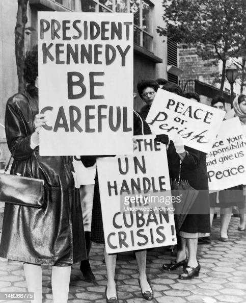 Group of women from Women Strike for Peace holding placards relating to the Cuban missile crisis and to peace New York New York 1962 They were part...