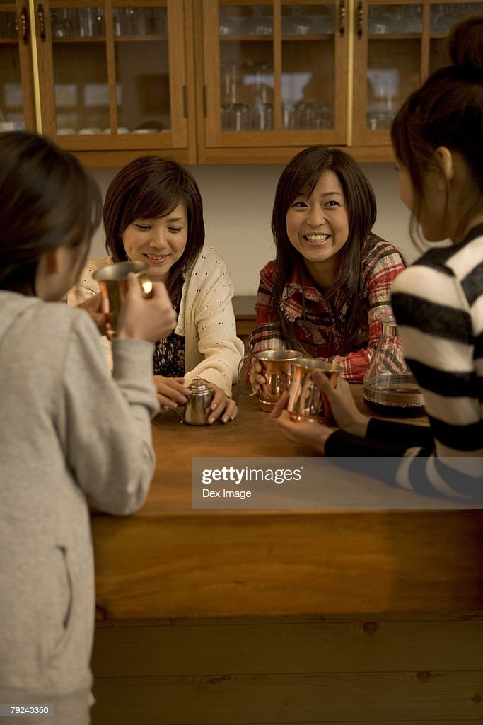 A group of women having coffee : Stock Photo