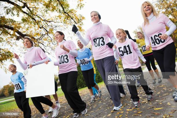 Group of women holding team sign in a charity race