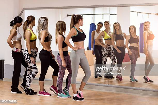 Group of Women how Posing on Mirror at the Gym