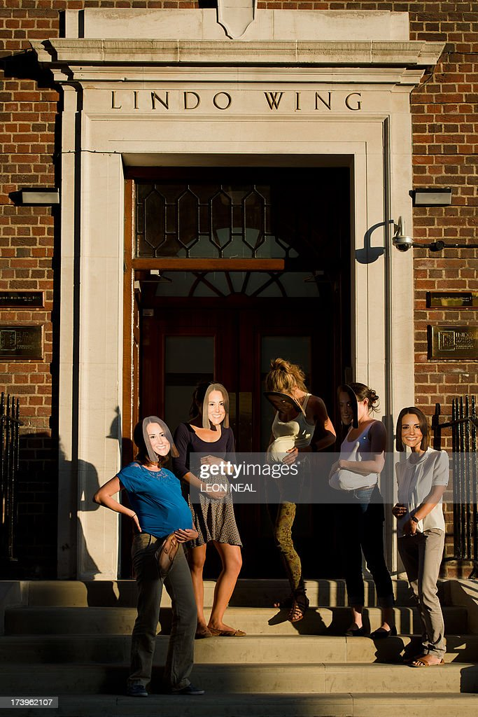 A group of women in Duchess of Cambridge masks stand outside the Lindo Wing of St Mary's Hospital in London, on July 18, 2013, where Prince William and his wife Catherine's baby is expected to be born. The long wait for the birth of Britain's royal baby is record business for bookmakers, as punters worldwide bet on a girl called Alexandra to be born any day now.