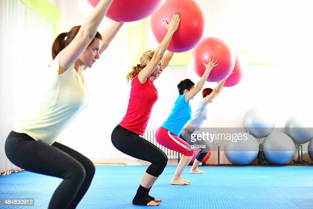 Group of women in Pilates class.