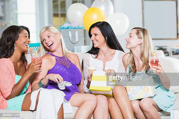 Group of women laughing at baby shower