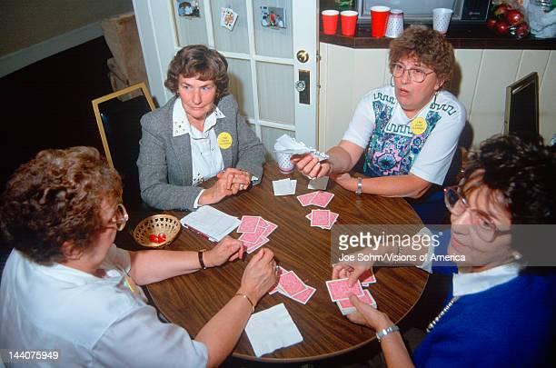 A group of women playing bridge NH