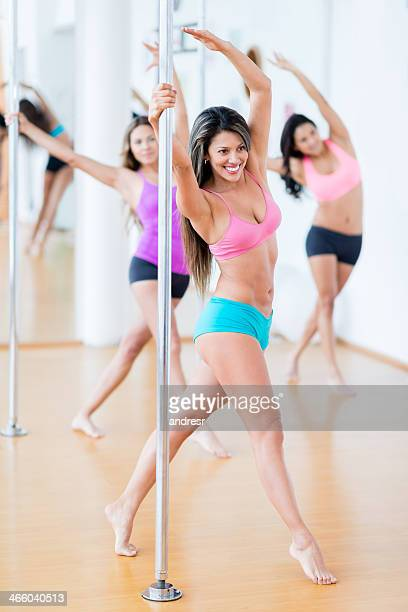 Group of women pole dancing