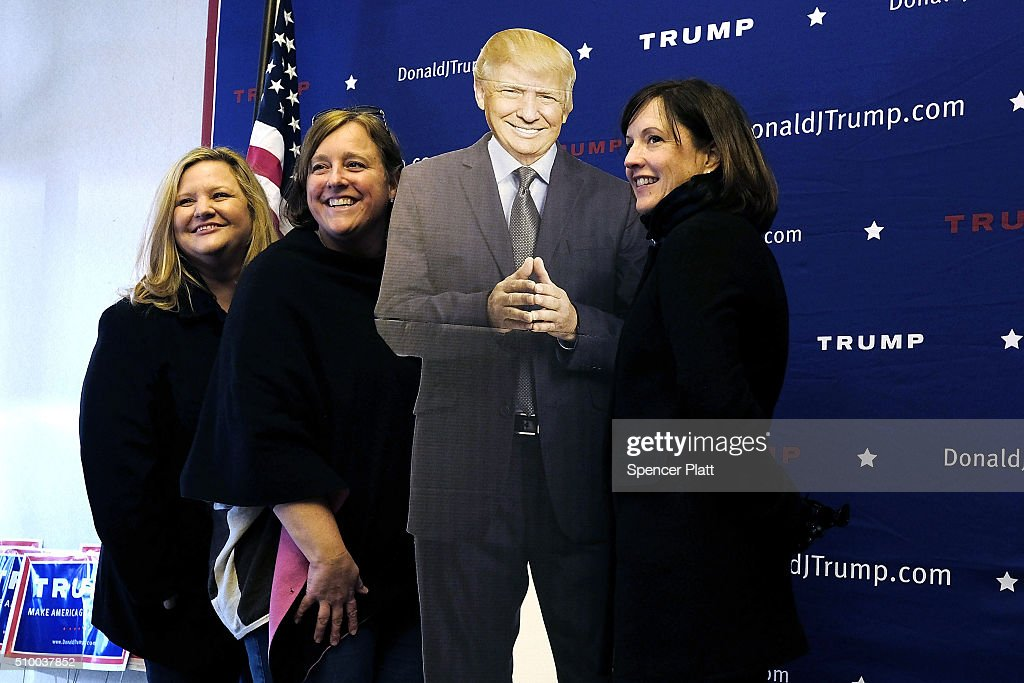 A group of women pose with a cardboard cutout of presidential candidate Donald Trump at his headquarters in Greenville on the day of the Republican Presidential debate on February 13, 2016 in Greenville, South Carolina. This evenings debate will see the six remaining candidates go at each other in a state known to reward more conservative candidates.